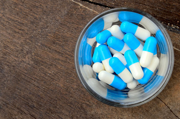 medicine capsule pill in glass