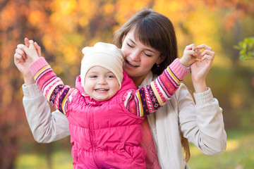 Happy family playing on autumn background