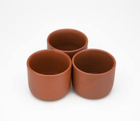 three clay cup isolated on white background