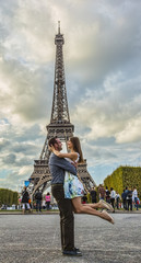 Happy Young Couple in Front of the Eiffel Tower