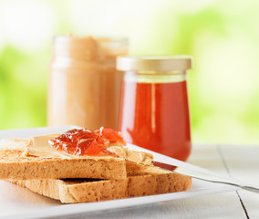 Toasts with peanut butter and strawberry jam