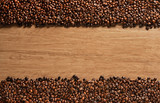 Fototapety Top view of coffee beans on old wooden background