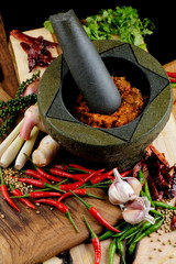 Asian herbs, spices and vegetables with mortar making curry
