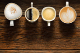 Variety of cups of coffee on old wooden table © amenic181