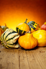 Assorted pumpkins and squashes on rustic wooden table