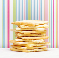 Yellow biscuits on striped background
