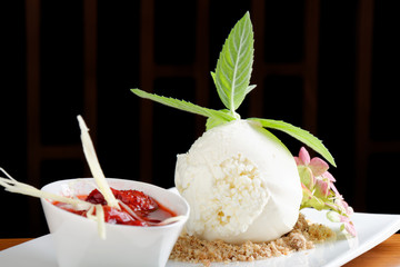 White ice cream with hot strawberry sauce, ginger and green bell