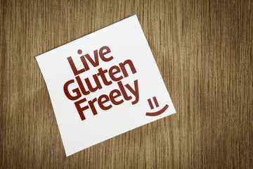Live Gluten Freely on Paper Note on texture background