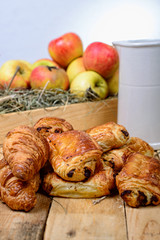 croissants and pains au chocolat with a box of apples