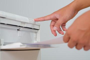 Business man press online button on printer.