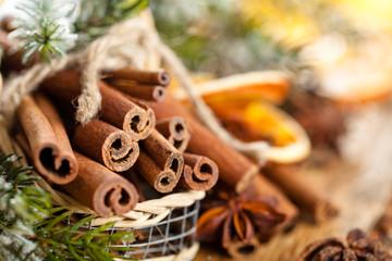 Cinnamon sticks in basket for Christmas day.