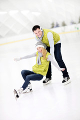 Happy couple in the ice rink
