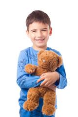 Boy hugging a teddy bear