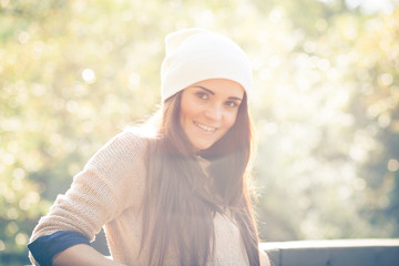 Young woman outdoor portrait, soft sunny daylight