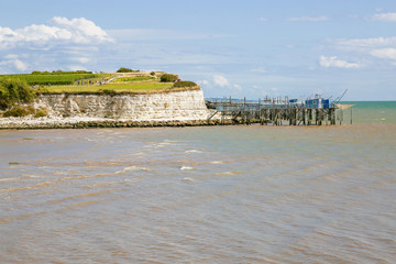 Estuary on the Atlantic side with cliffs and carrelets net,