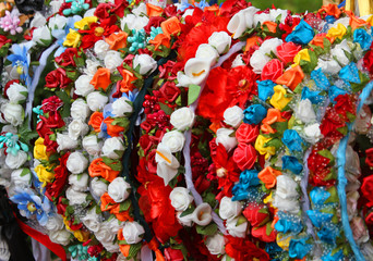 garlands and wreaths of flowers to decorate the head and hair of