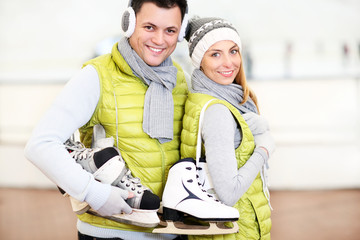 Cheerful couple in the skating rink