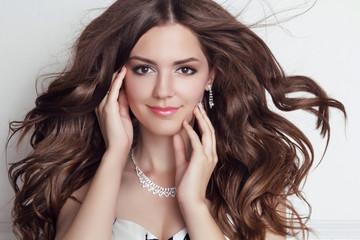 Long blowing hair. Beautiful brunette girl model with makeup, fa