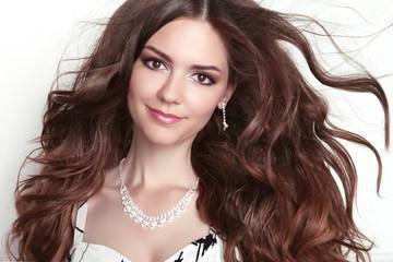 Beauty fashion smiling girl model portrait. Long healthy Wavy ha