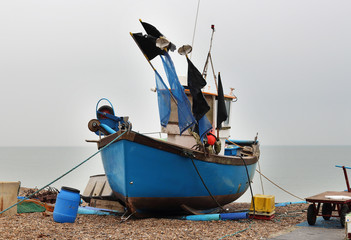 Boats beached on a shingle beach