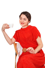 Woman holding a cup of coffee and cookies