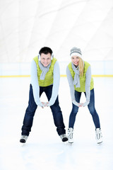 Cheerful couple on the skating rink