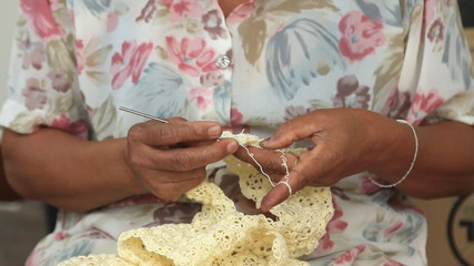 Close-up of old woman hands knitting.