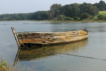 Boat wreck on a tidal estuary in Suffolk, UK