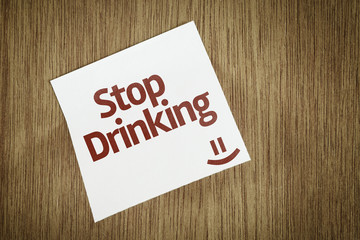 Stop Drinking on Paper Note on sky background