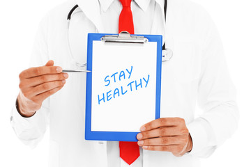 Midsection of a doctor pointing at stay healthy inscription
