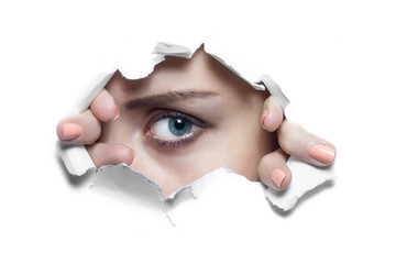 Woman Looking Through Ripped Paper Hole