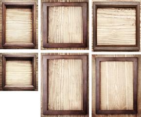 Old wooden frames on wood background