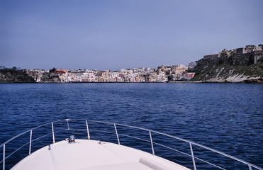 Italy, Procida Island, view of the island from a luxury yacht