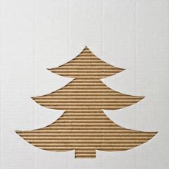 Spruce cut out on a corrugated cardboard