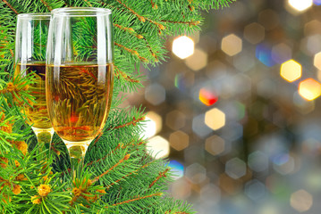 Two glasses of wine under the Christmas tree