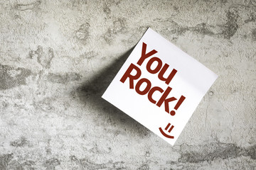 You Rock! on Paper Note on texture background
