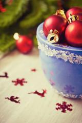 christmas balls in blue bowl