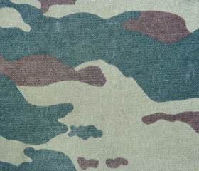 Background of a khaki pattern. Camouflage texture.
