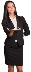 Beautiful businesswoman holds tablet