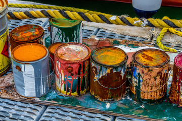 Colorful paint cans on the docks