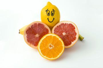 Smiley lemon,orange,grapefruit and banana on a white background