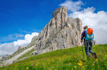 Young woman on a mountain trail, Dolomites Mountains, Italy