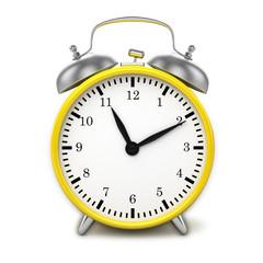 Yellow retro styled classic alarm clock isolated