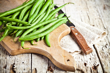 green string beans and knife