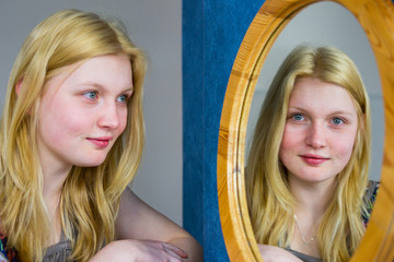 Blonde girl looking in mirror