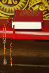 Hymnbook  and rosary religion still life