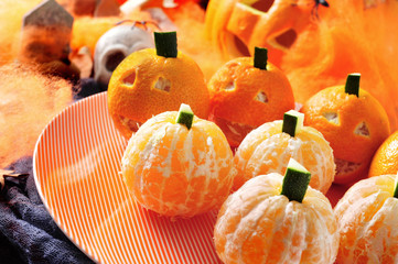 mandarines ornamented as Halloween pumpkins
