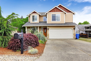 House exterior with beautiful curb appeal, garage and driveway v