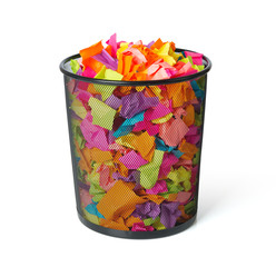 Full trash with colored paper on white background