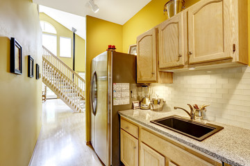 Small kitchen area with moden cabinets